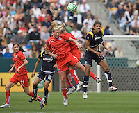 LA Sol's Shannon Boxx, right, tries for a head ball against Washington Freedom's Allie Long, left, during the WPS season opening game at the Home Depot Center, Sunday, March 29, 2009. The LA Sol won 2-0.