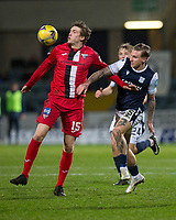 27th March 2021; Dens Park, Dundee, Scotland; Scottish Championship Football, Dundee FC versus Dunfermline; Iain Wilson of Dunfermline Athletic challenges for the ball with Jason Cummings of Dundee