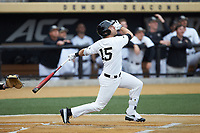Logan Harvey (15) of the Wake Forest Demon Deacons follows through on his swing against the Sacred Heart Pioneers at David F. Couch Ballpark on February 15, 2019 in  Winston-Salem, North Carolina.  The Demon Deacons defeated the Pioneers 14-1. (Brian Westerholt/Four Seam Images)