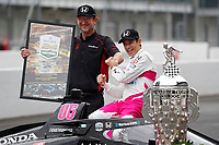 31th May 2021, Indianapolis, Indiana, USA;  NTT Indy Car Series driver Helio Castroneves poses for a photo  after winning the 105th running of the Indianapolis 500 at the winner's photo shoot on May 31, 2021 at the Indianapolis Motor Speedway in Indianapolis, Indiana.