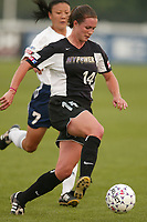 Wynne McIntosh of the New York Power is chased by Zhang Ouying of the San Diego Spirit. The Spirit defeated the Power 1-0 on July 20th at Mitchel Athletic Complex, Uniondale, NY.