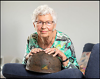 BNPS.co.uk (01202 558833)<br /> Pic: PhilYeomans/BNPS<br /> <br /> Willemein Rieken with the recently rediscovered helmet worn by Trooper Edmunds at Arnhem.<br /> <br /> Arnhem flowergirl finally honoured - Willemien was suprised to be presented with flowers and a certificate by Parachute Regiment veterans at the weekend.<br /> <br /> A Dutch woman who has tended to the grave of a British paratrooper killed at the Battle of Arnhem for 75 years has been presented with flowers from his regiment as a token of their gratitude.<br /> <br /> Every year Willemien Rieken, 84, lays flowers at Oosterbeek War Cemetery in memory of Trooper William Edmond who was shot by a German sniper after landing in Holland in World War Two.<br /> <br /> She was surprised at his grave by a member of Tpr Edmond's 1st Airborne Reconnaissance Squadron at a ceremony marking the 75th anniversary of the battle.