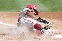 Arkansas outfielder Christian Franklin (25) slides home for a score, Saturday, April 3, 2021 during the sixth inning of a baseball game at Baum-Walker Stadium in Fayetteville. Check out nwaonline.com/210404Daily/ for today's photo gallery. <br /> (NWA Democrat-Gazette/Charlie Kaijo)