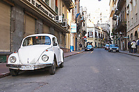 An old white Volkswagen Beetle probably from the 1960s parked on the street in the city near Plaza Independencia Independence Square Montevideo, Uruguay, South America