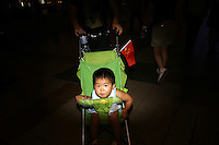 CHINA. Beijing. A mother and child in the shopping district of Wangfujing, a popular place for spectators, tourists and athletes to visit during the Olympic Games. 2008