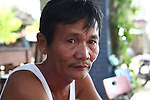 """Nguyen Tan Hoa, 55, sits outside his guesthouse near Da Nang, Vietnam. Hoa was 10 when U.S. Marines from a Combined Action Platoon moved into his village during the Vietnam War. For the next three years, he spent most of his time with the Marines and still refers to himself proudly as one of them. """"Whatever they got, I got,"""" he says. """"We shared everything."""" When Saigon fell to North Vietnamese forces in 1975, """"I really felt like I was the last G.I. in Vietnam,"""" he says. Aug. 10, 2012."""