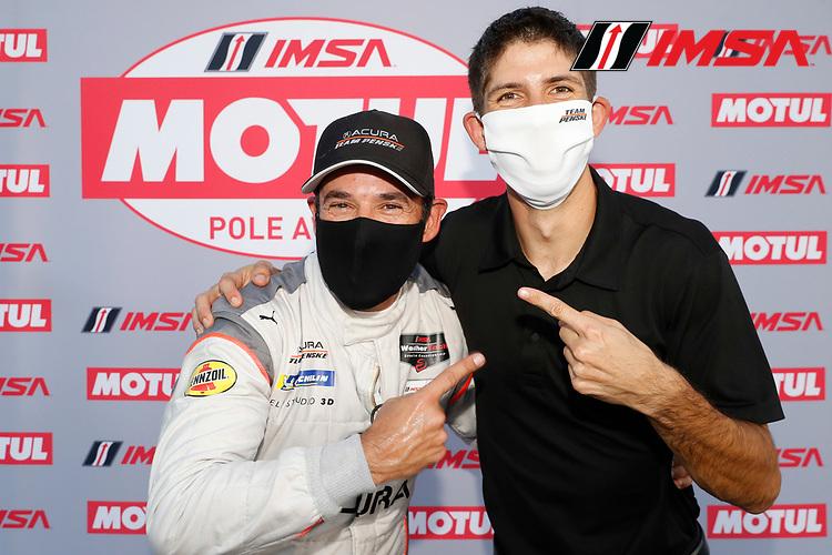DPI Motul Pole award winner #7 Acura Team Penske Acura DPi, DPi: Helio Castroneves with teammate Ricky Taylor
