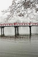 The vermilion bridge that crosses Matsumoto Castle Moat on a snowy winter day.