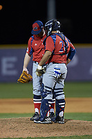 NJIT Highlanders catcher Edgar Badaraco (28) has a chat on the mound with relief pitcher Bryan Haberstroh (7) during the game against the High Point Panthers at Williard Stadium on February 18, 2017 in High Point, North Carolina. The Highlanders defeated the Panthers 4-2 in game two of a double-header. (Brian Westerholt/Four Seam Images)