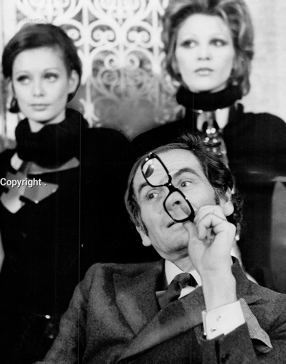 Paris designer Pierre Cardin chewing glasses. I like my women to be natural . . . dislike sophisticated hairdos<br /> <br /> Griffin, Doug<br /> Picture, 1969