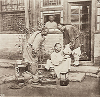 BNPS.co.uk (01202 558833)<br /> Pic: ForumAuctions/BNPS<br /> <br /> Pictured: Scotsman, John Thomson photographed street sellers<br /> <br /> Rarely seen 150 year old photos taken by one of the first British photographers to explore China have emerged for sale for £20,000.<br /> <br /> Scotsman John Thomson (1837-1921) travelled to the Far East in 1868 and established a studio in Hong Kong, using it as a base to explore remote parts of the vast country for the next four years, photographing landmarks, scenery and the native population.<br /> <br /> In many cases, he was the first Westerner the people he photographed had encountered.<br /> <br /> One striking image shows a prisoner in chains with a head poking through a board covered in Chinese symbols, perhaps listing his misdemeanours. In another, a man poses next to a giant camel statue in the grounds around the Ming tombs of the Forbidden City.<br /> <br /> Almost 100 of his photos feature in a rare first edition of 'Thomson Illustrations of China and Its People' (1873), which is going under the hammer with London-based Forum Auctions.