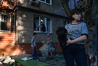 Citizens of Slavyansk try to repair their home struck by shelling. Slovyansk, Ukraine.