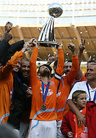 Houston captain Wade Barrett holds up the Alan I. Rothenberg trophy as MLS champions. The Houston Dynamo defeated the New England Revolution 2-1 in the finals of the MLS Cup at RFK Memorial Stadium in Washington, D. C., on November 18, 2007.