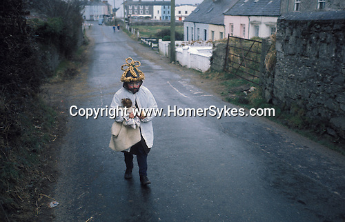 Biddy Boys 1970s. Killorglin, Co Kerry Ireland. February 2nd festival to celebrate the Celtic Saint Bridgid. A doll - St Bridgid - is taken from house to house by even the youngest Biddy Boys.