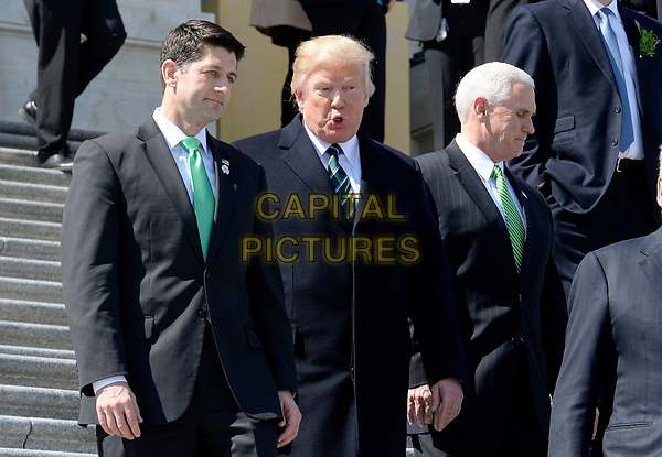 United States President Donald J. Trump, center, and US House Speaker Paul Ryan (Republican of Wisconsin), left, walk down the steps of the US Capitol after attending the Friends of Ireland Luncheon at the U.S Capitol on March 16, 2017 in Washington, DC.  US Vice President Mike Pence is at right.<br /> CAP/MPI/CNP/RS<br /> ©RS/CNP/MPI/Capital Pictures