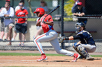 Philadelphia Phillies outfielder Yan Olmo (3) at bat in front of catcher Wes Wilson #35 during a minor league Spring Training game against the New York Yankees at Carpenter Complex on March 21, 2013 in Clearwater, Florida.  (Mike Janes/Four Seam Images)