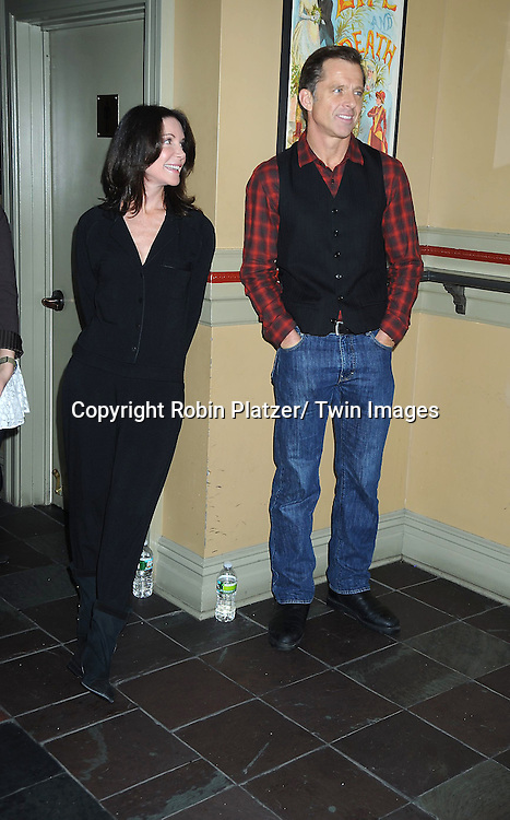 """Lois Robbins and Maxwell Caulfield posing for photographers at the photo call .for """" Cactus Flower"""" on February 1, 2011 at The Westside Theatre Upstairs in New York City. The stars are Maxwell Caulfield, .Lois Robbins and Jenni Barber."""