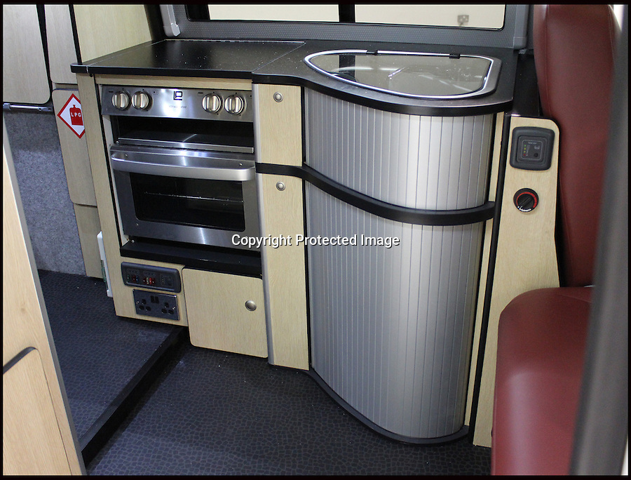 BNPS.co.uk (01202 558833).Pic: Danbury/BNPS..***Please Use Full Byline***..Glamper Van...All mod con's...This van-tastic camper is guaranteed to turn heads after engineers used Thunderbirds-style technology to double living space at the touch of a button...It might look just like any other Volkswagen camper with all the usual mod-cons like a built-in cooker, fridge, convertible bed and even a lifting roof...But the new T5 Doubleback hides a secret compartment that automatically slides out by flicking a switch...The new invention transforms the elongated van into a 26ft long home on wheels and doubles the living space....