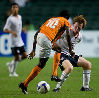 US midefielder (5) Dax McCarty stays close to Ivory Coast's (10) Kouamatien Emmanuel Kone during the game at Hong Kong Stadium.  The US Men's Olympic team tied Ivory Coast, 0-0, during the ING Cup in Hong Kong.
