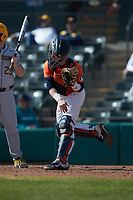 Illinois Fighting Illini catcher JacobCampbell (9) follows through on a throw to second base during the game against the West Virginia Mountaineers at TicketReturn.com Field at Pelicans Ballpark on February 23, 2020 in Myrtle Beach, South Carolina. The Fighting Illini defeated the Mountaineers 2-1.  (Brian Westerholt/Four Seam Images)