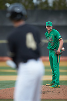Notre Dame Fighting Irish starting pitcher Cameron Junker (32) looks to the catcher for the sign as DJ Poteet (4) of the Wake Forest Demon Deacons steps up to the plate at David F. Couch Ballpark on March 10, 2019 in  Winston-Salem, North Carolina. The Fighting Irish defeated the Demon Deacons 8-7 in 10 innings in game two of a double-header. (Brian Westerholt/Four Seam Images)