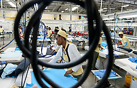 ETHIOPIA , Southern Nations, Hawassa or Awasa, Hawassa Industrial Park, chinese-built for the ethiopian government to attract foreign investors with low rent and tax free to establish a textile industry and create thousands of new jobs, taiwanese company Everest Textile Co. Ltd.produces textiles from synthetic fabric for export, ironing department / AETHIOPIEN, Hawassa, Industriepark, gebaut durch chinesische Firmen fuer die ethiopische Regierung um die Hallen fuer Textilbetriebe von Investoren zu vermieten, taiwanesische Firma Everest Textile Co. Ltd. produziert Textilien aus synthetischen Stoffen fuer den Export