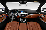 Stock photo of straight dashboard view of 2020 BMW 3-Series M-Sport 5 Door Wagon Dashboard