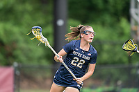 NEWTON, MA - MAY 22: Hannah Dorney #22 of Notre Dame behind the net during NCAA Division I Women's Lacrosse Tournament quarterfinal round game between Notre Dame and Boston College at Newton Campus Lacrosse Field on May 22, 2021 in Newton, Massachusetts.