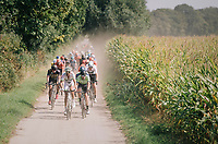 "peloton conquering the gravel sectors<br /> <br /> Antwerp Port Epic 2018 (formerly ""Schaal Sels"")<br /> One Day Race:  Antwerp > Antwerp (207 km; of which 32km are cobbles & 30km is gravel/off-road!)"