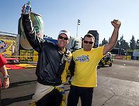 Nov 10, 2013; Pomona, CA, USA; NHRA pro stock driver Jeg Coughlin Jr celebrates with a crew member after clinching the 2013 pro stock championship during the Auto Club Finals at Auto Club Raceway at Pomona. Mandatory Credit: Mark J. Rebilas-