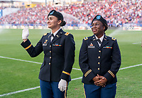 FRISCO, TX - MARCH 11: Military escorts wave to the crowd during a game between Japan and USWNT at Toyota Stadium on March 11, 2020 in Frisco, Texas.