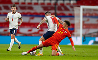8th Occtober 2020, Wembley Stadium, London, England;  Wales Ethan Ampadu fouls Englands Danny Ings during a friendly match between England and Wales in London
