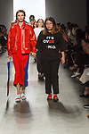 Graduating design student Emily Roe, walks runway with model at the close of 2017 Pratt fashion show on May 4, 2017 at Spring Studios in New York City.