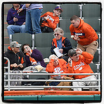 A fan in the left field stands flubs a home run ball hit by South Alabama's Ethan Wilson in a game against the Clemson Tigers on Opening Day, Friday, February 15, 2019, at Doug Kingsmore Stadium in Clemson, South Carolina. Clemson won, 6-2. (Tom Priddy/Four Seam Images)