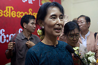 Myanmar's newly-released opposition leader Aung San Suu Kyi talks to the assembled media at the National League for Democracy (NLD) headquarters in Rangoon. From 1990 until her release on 13 November 2010, Aung San Suu Kyi had spent almost 15 of the 21 years under house arrest.