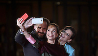 """From left: British actor Ralph Fiennes take a selfie with British actress Kristin Scott Thomas and French actress Juliette Binoche on the red carpet as they arrive for the screening of the movie """"The English Patient"""" during the international Rome Film Festival at Rome's Auditorium, 22 October 2016. The Film Festival celebrates one of the most beloved of Cinema History 'The English Patient' by Anthony Minghella, released twenty years ago (in 1996). <br /> UPDATE IMAGES PRESS/Isabella Bonotto"""