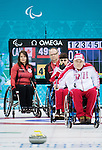 Sochi, RUSSIA - Mar 8 2014 -  Ina Forrest and Dennis Thiessen look on as Canada takes on Russia in Wheelchair Curling during the 2014 Paralympic Winter Games in Sochi, Russia.  (Photo: Matthew Murnaghan/Canadian Paralympic Committee)