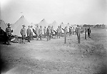 ENCAMPMENT AT THE FAIRGROUNDS. The bleachers, visible between the tents in the image above, and the grandstand backdrop of the photograph below indicate that this military encampment took place at the Nebraska State Fairgrounds in Lincoln. While this sounds like safe duty, hundreds of Lincoln men and several women enlisted in the military during the Great War and dozens died, including two women nurses. A local Red Cross chapter of African American women rolled bandages for wounded soldiers. Several men of the community enlisted, including Dakota Talbert . Two black soldiers from Lincoln, Horace Colley and Clinton Ross, were commissioned as lieutenants.<br /> <br /> Photographs taken on black and white glass negatives by African American photographer(s) John Johnson and Earl McWilliams from 1910 to 1925 in Lincoln, Nebraska. Douglas Keister has 280 5x7 glass negatives taken by these photographers. Larger scans available on request.