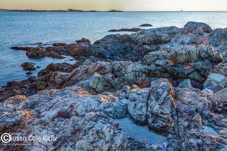 Sunrise on the rocky New England coast in Marblehead, MA, USA