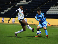 29th December 2020; Deepdale Stadium, Preston, Lancashire, England; English Football League Championship Football, Preston North End versus Coventry City; Darnell Fisher of Preston North End prevents Josh Pask of Coventry City from crossing the ball