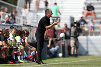 CARY, NC - SEPTEMBER 12: Head coach Mark Parsons of the Portland Thorns FC encourages his team during a game between Portland Thorns FC and North Carolina Courage at Sahlen's Stadium at WakeMed Soccer Park on September 12, 2021 in Cary, North Carolina.