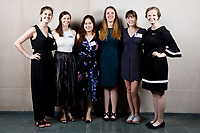 USA International Harp Competition organizers Carrie Anderson, left, Erin Brooker-Miller, Cindy Songwon Lee, Abigail Brower, Caroline Robinson and Melanie Mashner pose at a photo booth during the opening reception and dinner of the 11th USA International Harp Competition at Indiana University in Bloomington, Indiana on Wednesday, July 3, 2019. (Photo by James Brosher)