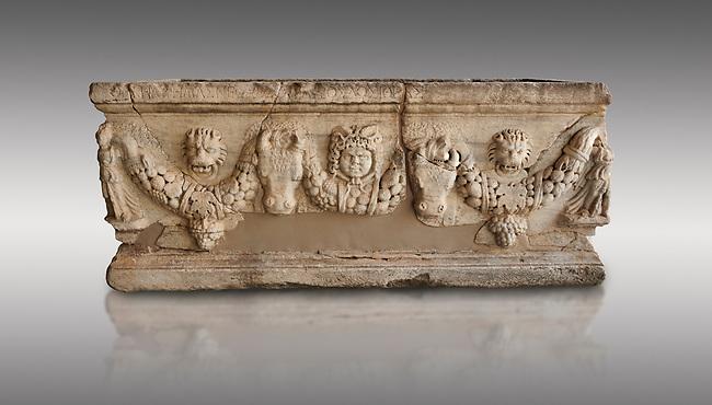 Roman relief garland sculpted sarcophagus.  Adana Archaeology Museum, Turkey. Against a grey background