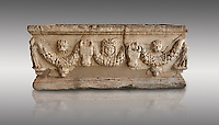 Roman relief garland sculpted sarcophagus.  Adana Archaeology Museum, Turkey. Against a grey background