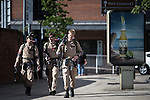 © Joel Goodman - 07973 332324 . 25/07/2015 . Manchester , UK . Ghostbusters . Visitors to Comic Con on the streets of Manchester after venue - Manchester Central's - doors are shut . Photo credit : Joel Goodman