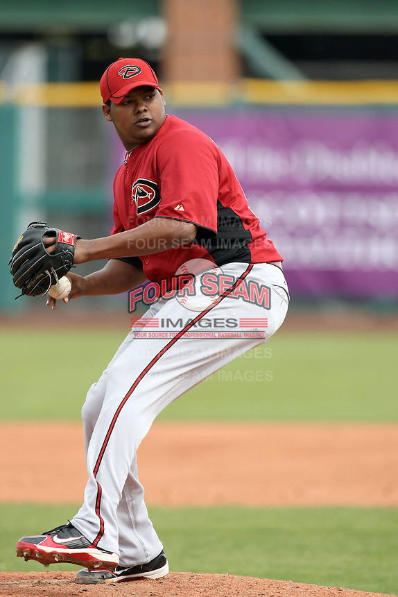 Yonata Ortega #56 of the Arizona Diamondbacks pitches against the San Francisco Giants in the first spring training game of the season at Scottsdale Stadium on February 25, 2011  in Scottsdale, Arizona. .Photo by:  Bill Mitchell/Four Seam Images.