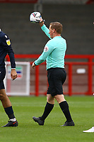 The Referee takes away the burst ball during Crawley Town vs Morecambe, Sky Bet EFL League 2 Football at Broadfield Stadium on 17th October 2020