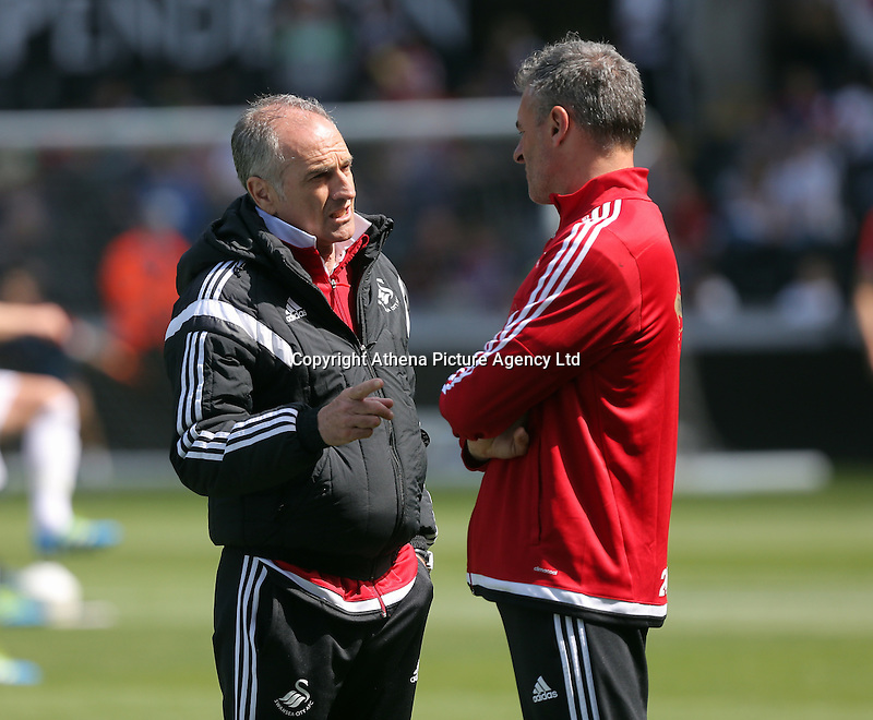 ( L-R ) Francesco Guidolin, Manager of Swansea City and assistant Diego Bortoluzzi during the Swansea City FC v Manchester City Premier League game at the Liberty Stadium, Swansea, Wales, UK, Sunday 15 May 2016