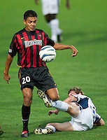 Amado Guevara of the MetroStars and Steve Ralston of the Revolution go for ball. The New England Revolution were defeated by the NY/NJ MetroStars 2-1 during quarterfinals action of the Lamar Hunt U.S. Open Cup on 8/27/03 at Yurcak Field, Rutgers University, Piscataway, NJ..