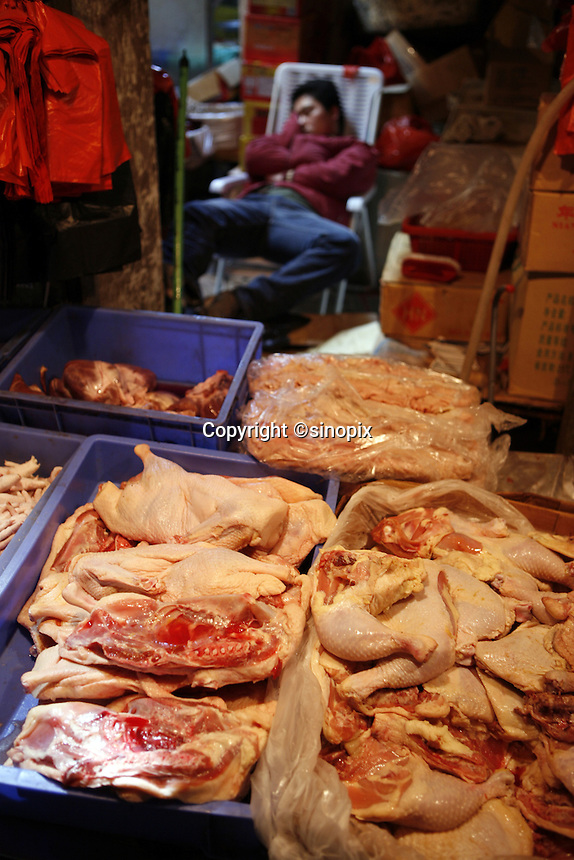 Rows of chicken parts and pork cuts for sale at the Shenzhen Buji agriculture market.<br /> Shenzhen, China